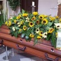 Sargfeier mit Sargauflage Sonnenblumen